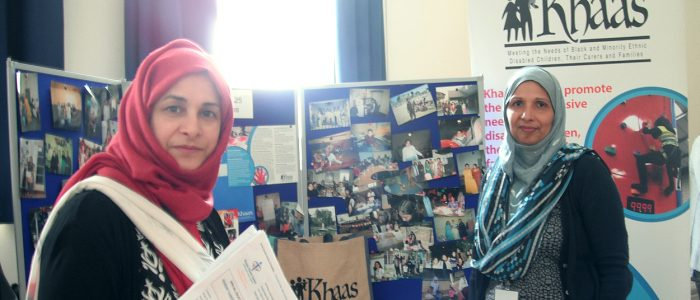 Frida and Saiqa with Khaas information stand